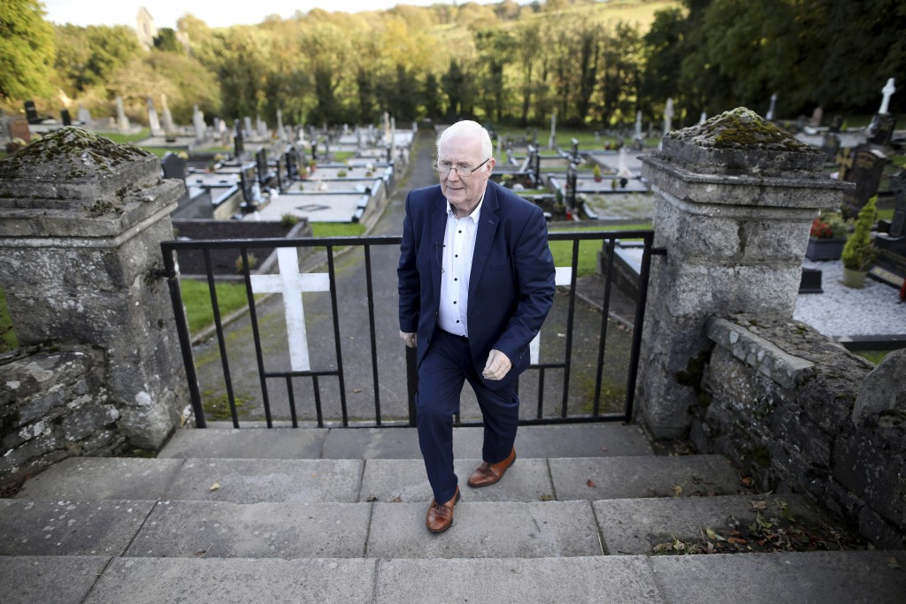 In this photo taken on Wednesday Oct. 16, 2019, Eugene Reavey leaves after visiting the graves of his three brothers in Whitecross in South Armagh, No