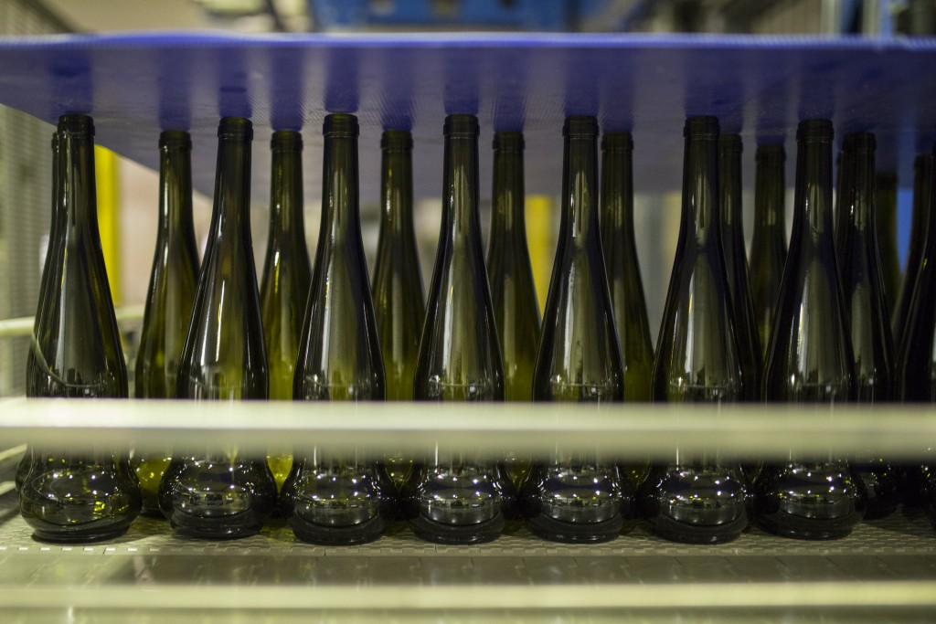 Empty wine bottles sit on a production line in the southern France region of Provence, Friday Oct. 11, 2019. European producers of premium specialty a...