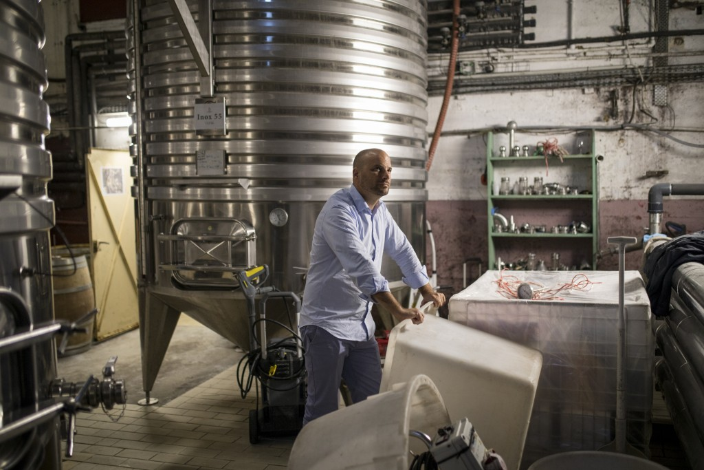 Sebastien Latz, director general of the French wine producer MDCV, poses in a wine production facility in the Chateau des Bertrands vineyard in Le Can...