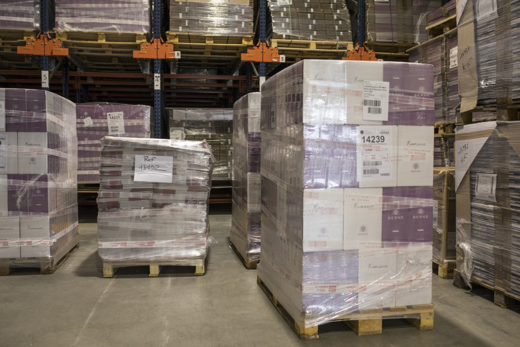 Wine cases ready for shipment sit in a warehouse in Le Cannet-des-Maures, in the Provence region, Thursday Oct. 10, 2019. European producers of premiu...