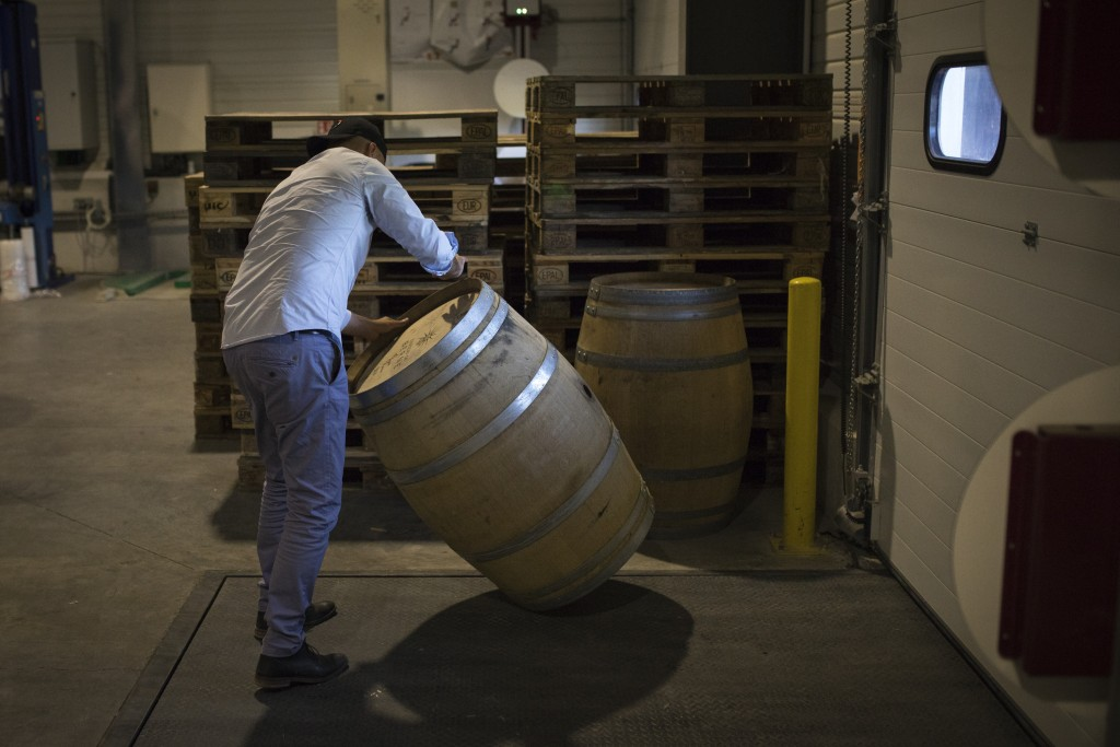 An employee moves an empty barrel in the shipping warehouse of the French wine producer MDCV, in the Chateau des Bertrands in Le Cannet-des-Maures, in...