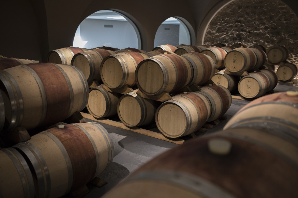 Wine barrels sit in a wine cellar in the southern France region of Provence, Friday Oct. 11, 2019. European producers of premium specialty agricultura...