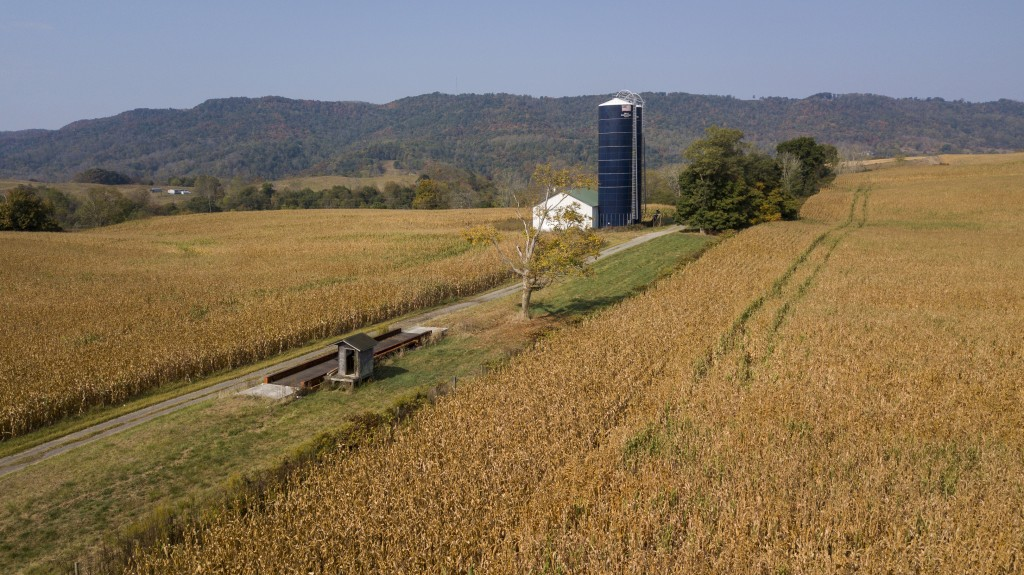 This Oct. 1, 2019 aerial photos shows farm buildings surrounded by a crop of corn on a farm owned by the family of West Virginia Gov. Jim Justice near...