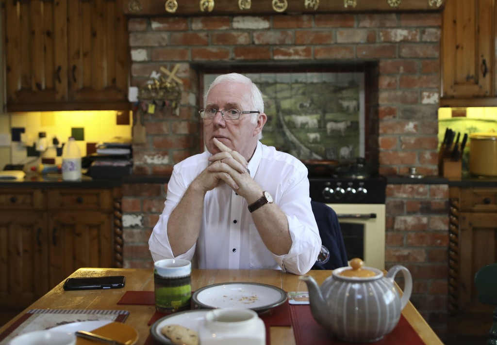 In this photo taken Wednesday Oct. 16, 2019 Eugene Reavey talks to the Associated Press at his home in Whitecross in South Armagh,Northern Ireland. Pe