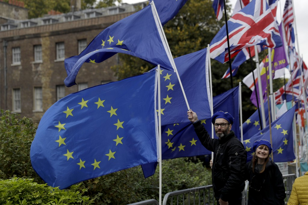 Anti-Brexit remain in the European Union supporters protest with European flags opposite the Houses of Parliament in London, Thursday, Oct. 17, 2019.