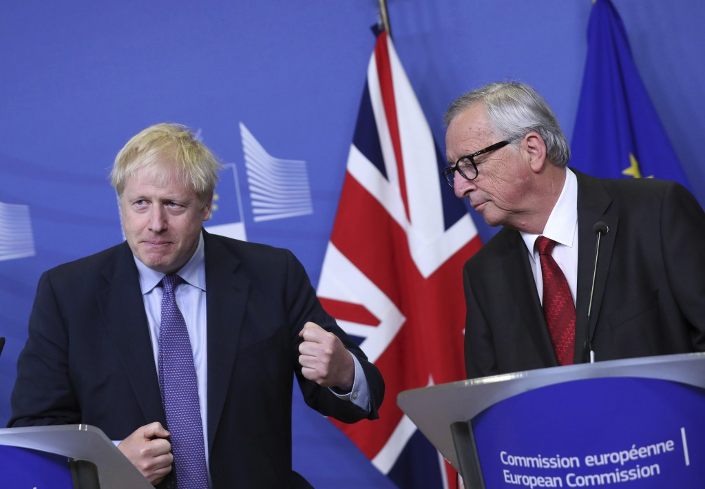 British Prime Minister Boris Johnson gestures as he stands alongside European Commission President Jean-Claude Juncker during a press point at EU head...