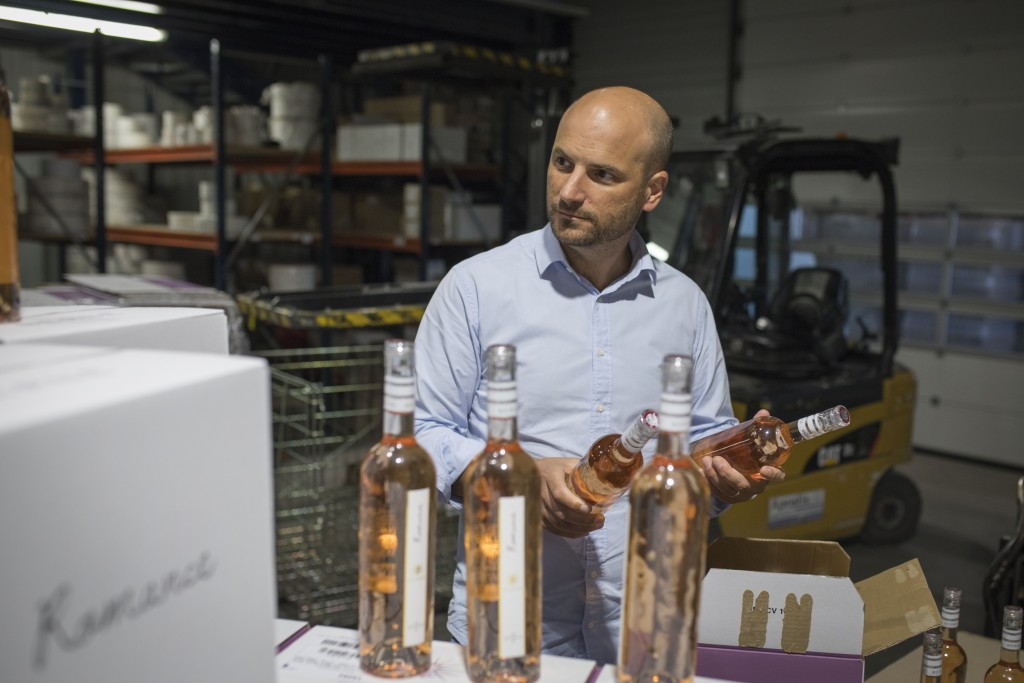 Sebastien Latz, director general of the French wine producer MDCV, inspects bottles of rosé in a wine production facility in the Chateau des Bertrands...