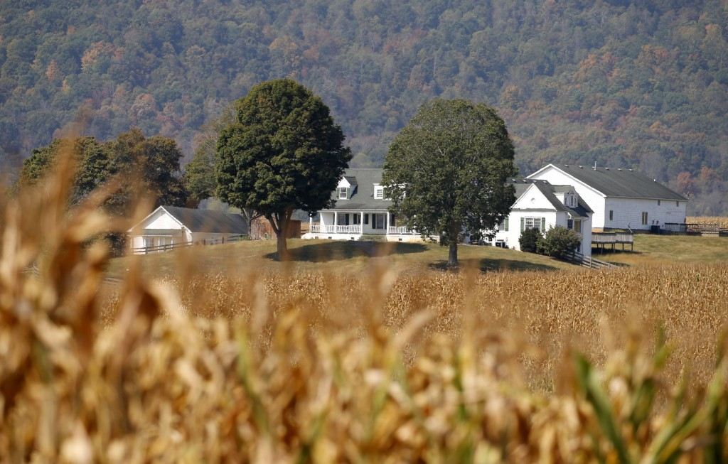 This Oct. 1, 2019 photo shows a farm house on a farm owned by the family of West Virginia Gov. Jim Justice near Lewisburg, W.Va. Justice Farms of Nort...
