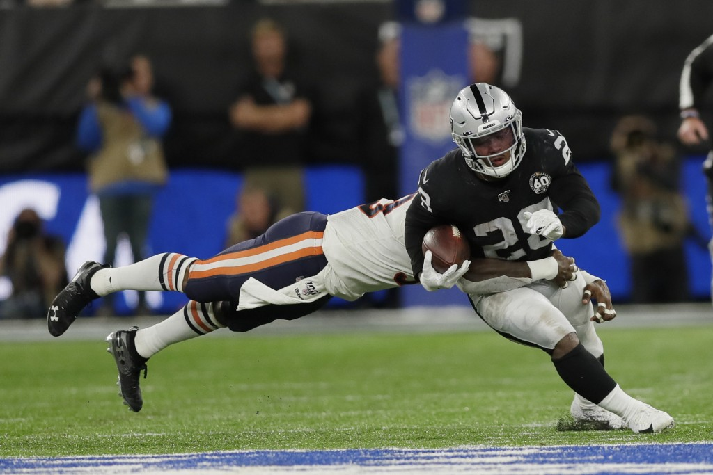Oakland Raiders running back Josh Jacobs (28) is tackled during the second half of an NFL football game against the Chicago Bears at Tottenham Hotspur...