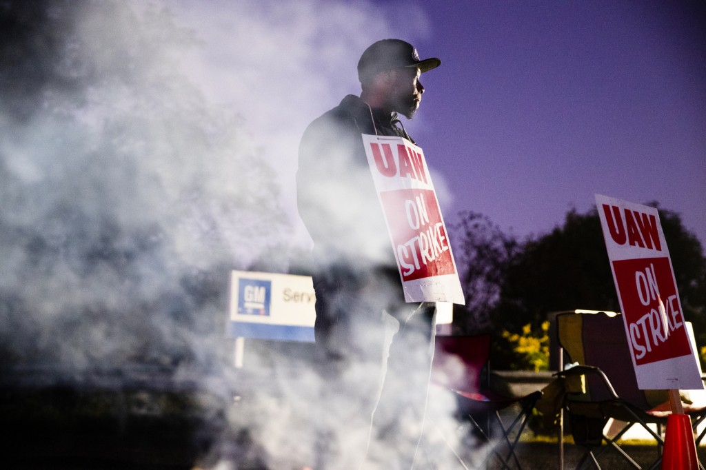 FILE- In this Sept. 27, 2019, file photo worker Omar Glover pickets outside a General Motors facility in Langhorne, Pa.  A tentative four year contrac...