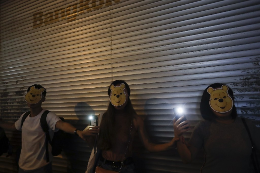 Protesters wear Winnie the Pooh masks during a protest in Hong Kong, Friday, Oct. 18, 2019. Hong Kong pro-democracy protesters are donning cartoon/sup...