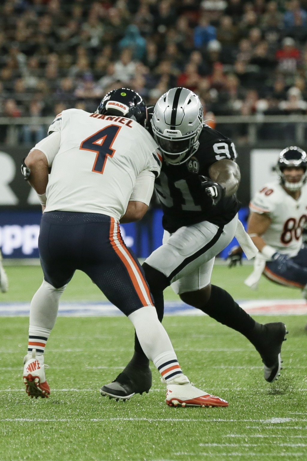 Chicago Bears quarterback Chase Daniel (4) is sacked by Oakland Raiders defensive end Benson Mayowa (91) during the first half of an NFL football game...