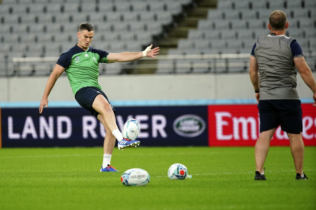 Jonathan Sexton of Ireland warms up during a training session Friday, Oct. 18, 2019, in Tokyo. (AP Photo/Eugene Hoshiko)