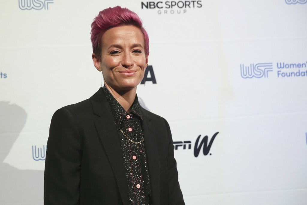 In this Wednesday, Oct. 16, 2019, photo soccer star Megan Rapinoe poses for photos on the red carpet of the Women's Sports Foundation's 40th annual Sa...