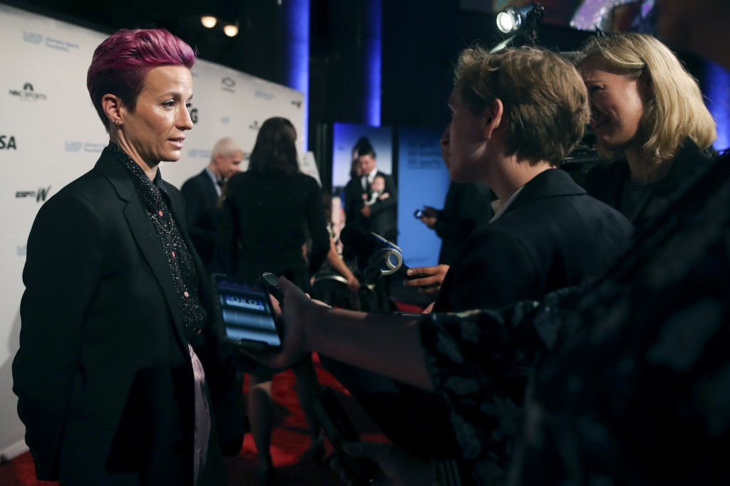In this Wednesday, Oct. 16, 2019, photo, soccer star Megan Rapinoe talks to reporters on the red carpet of the Women's Sports Foundation's 40th annual...
