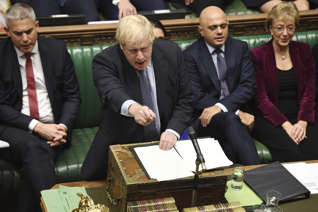 Britain's Prime Minister Boris Johnson speaks to lawmakers inside the House of Commons to update details of his new Brexit deal with EU, in London Sat...