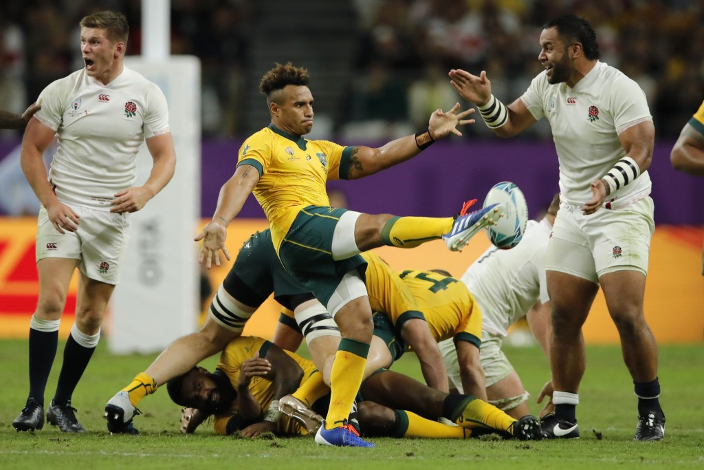 Australia's Will Genia kicks the ball during the Rugby World Cup quarterfinal match against England at Oita Stadium in Oita, Japan, Saturday, Oct. 19,...
