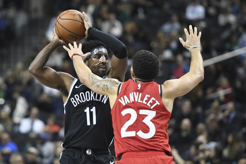 Brooklyn Nets guard Kyrie Irving (11) looks to pass as Toronto Raptors guard Fred VanVleet (23) defends during the third quarter of a preseason NBA ba...