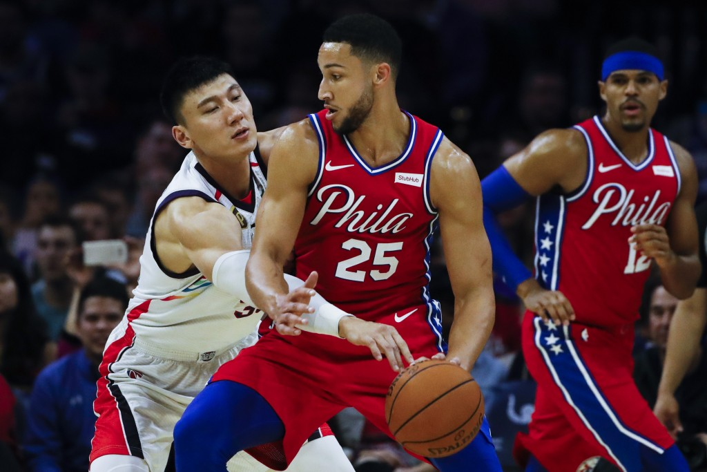 Philadelphia 76ers' Ben Simmons (25) drives to the net as Guangzhou Loong-Lions' Yongpeng Zhang defends and Philadelphia 76ers' Tobias Harris, right, ...