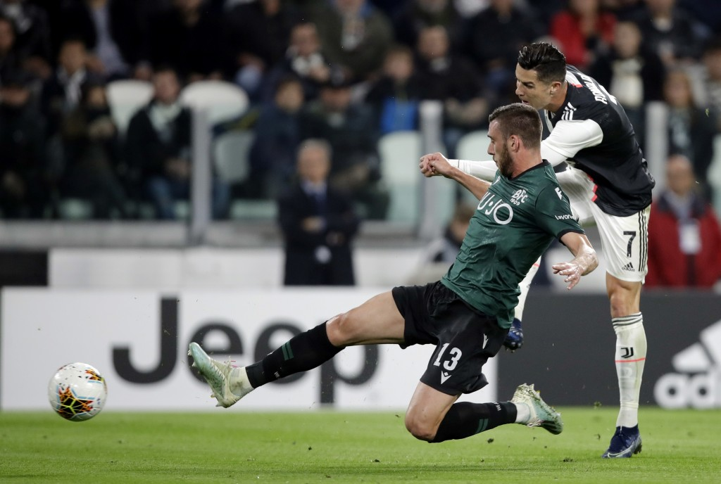 Juventus' Cristiano Ronaldo scores the opening goal during a Serie A soccer match between Juventus and Bologna, at the Allianz stadium in Turin, Italy...
