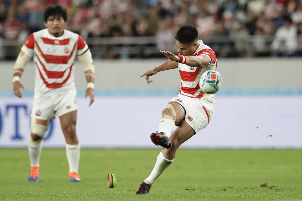 Japan's Yu Tamura kicks a penalty goal during the Rugby World Cup quarterfinal match at Tokyo Stadium between Japan and South Africa in Tokyo, Japan, ...