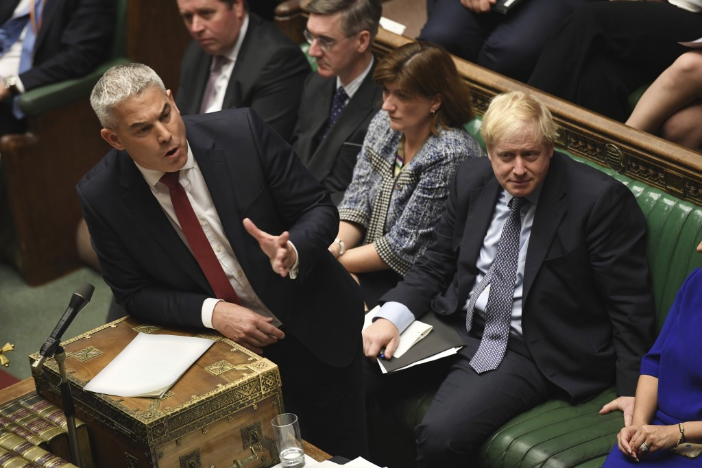 Secretary of State for Exiting the European Union lawmaker Stephen Barclay speaks during the Brexit debate, watched by Prime Minister Boris Johnson, r...