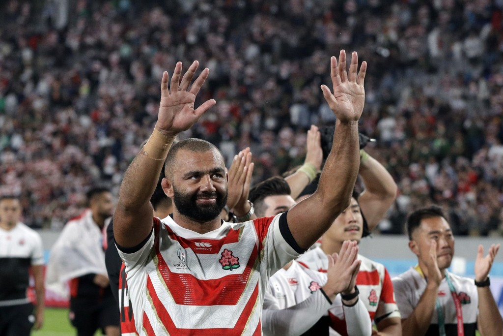 Japan's Michael Leitch waves fans after being defeated by South Africa during the Rugby World Cup quarterfinal match at Tokyo Stadium between Japan an...