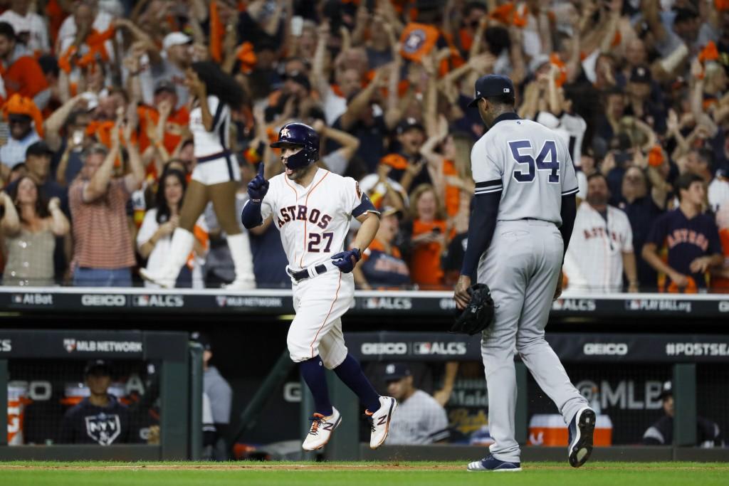 Houston Astros' Jose Altuve celebrates walk off against New York Yankees pitcher Aroldis Chapman to win Game 6 of baseball's American League Champions...