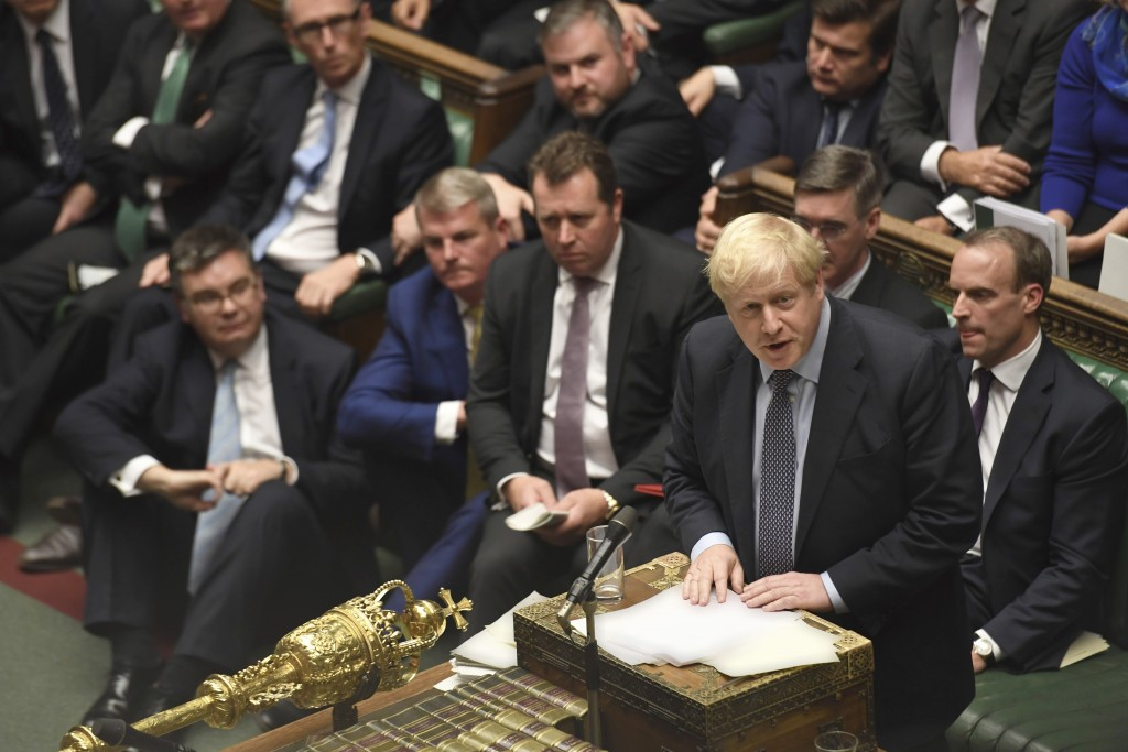 Britain's Prime Minister Boris Johnson speaks during the Brexit debate inside the House of Commons in London Saturday Oct. 19, 2019. At the rare weeke...