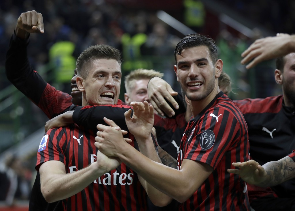 AC Milan's Krzysztof Piatek, left, celebrates his goal with teammates during a Serie A soccer match between AC Milan and Lecce, at the San Siro stadiu...