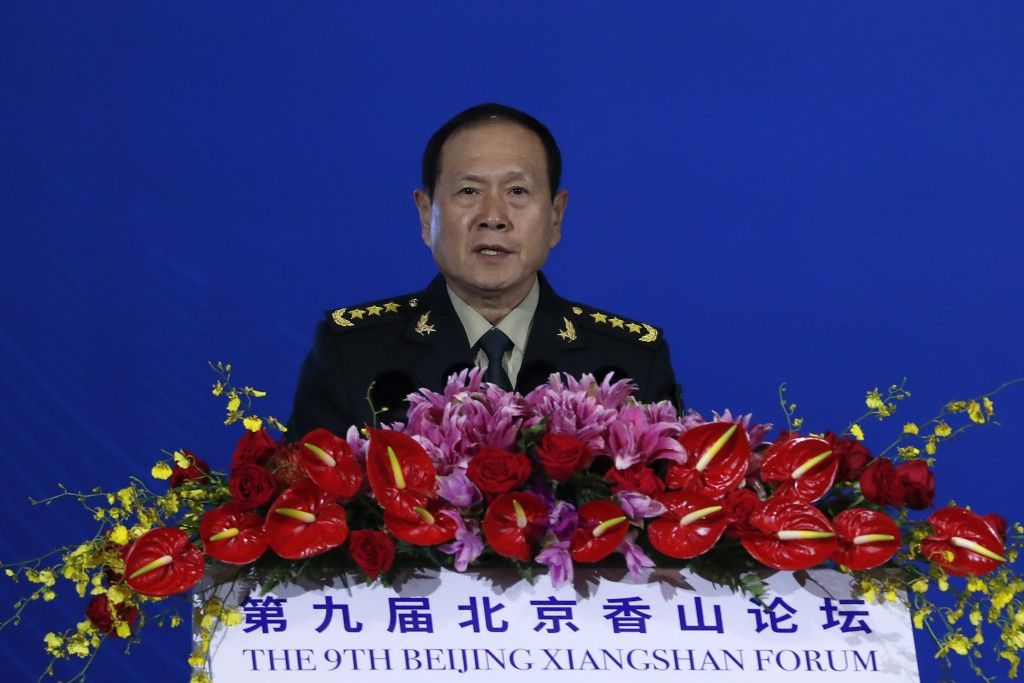 Chinese Defense Minister Wei Fenghe delivers his opening speech for the Xiangshan Forum, a gathering of the region's security officials, in Beijing, M...