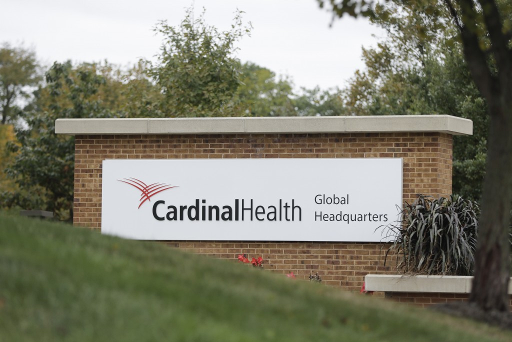 FILE - This Oct. 16, 2019, file photo shows a sign of the Cardinal Health, Inc. corporate office in Dublin, Ohio. A committee guiding OxyContin maker ...