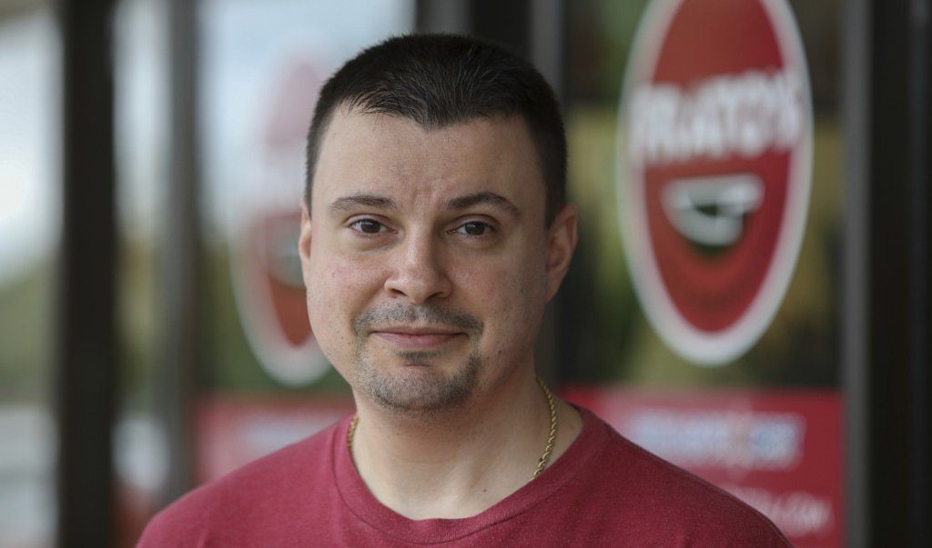 Owner Michael Kudrna poses in front of Frato's Pizza in Schaumburg, Ill., on Sept. 6, 2019. Frato's looks like a typical restaurant, but in the kitche...