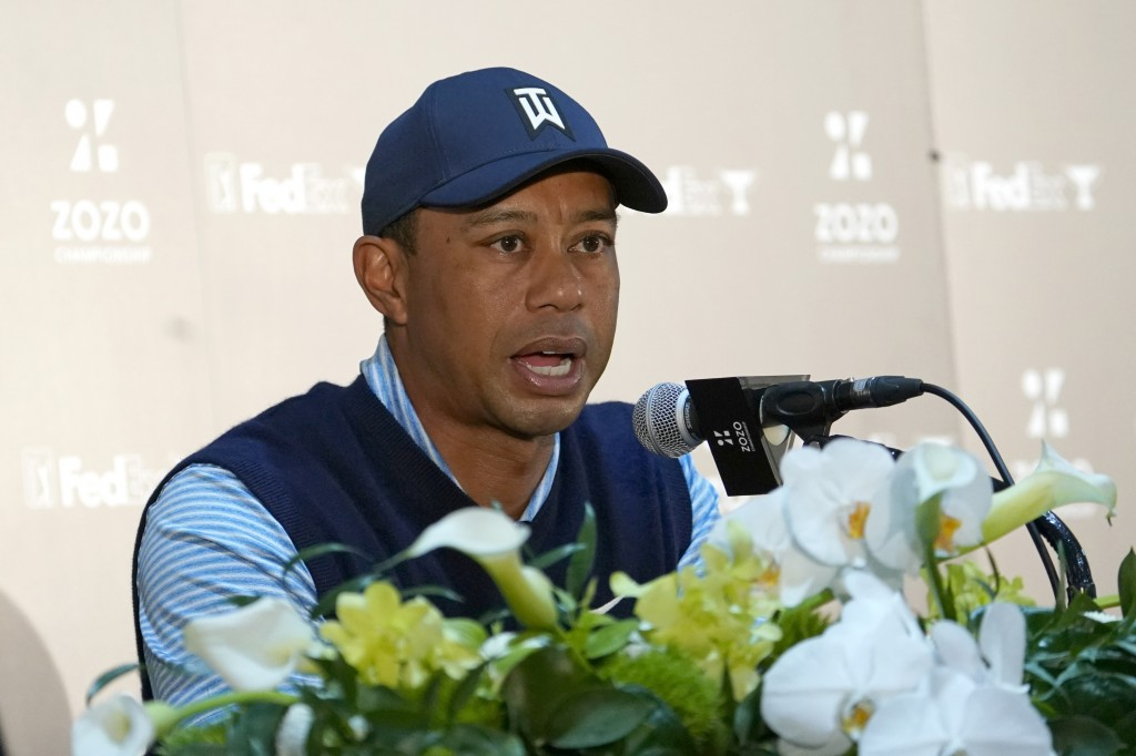 Tiger Woods of the United States answers a reporter's question during a news conference ahead of the Challenge: Japan Skins event at Accordia Golf Nar...