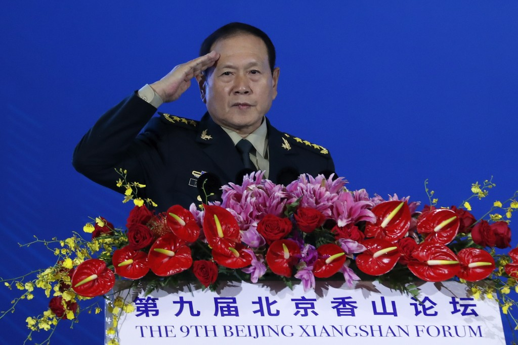 Chinese Defense Minister Wei Fenghe salutes after delivering his opening speech for the Xiangshan Forum, a gathering of the region's security official...