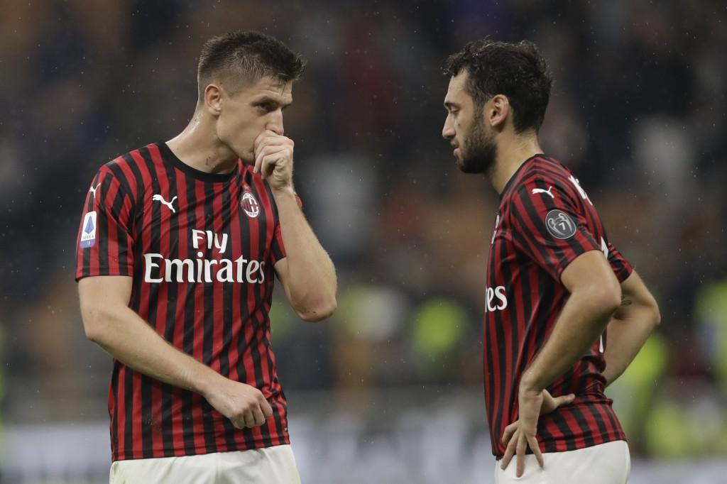 AC Milan's Krzysztof Piatek, left, and AC Milan's Hakan Calhanoglu react at the end of Serie A soccer match between AC Milan and Lecce, at the San Sir...