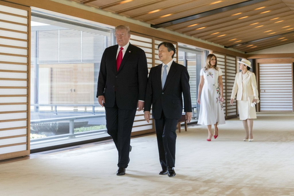 FILE - In this May 27, 2019, file photo released by Imperial Household Agency of Japan, U.S. President Donald Trump, left, talks with Japan's Emperor ...