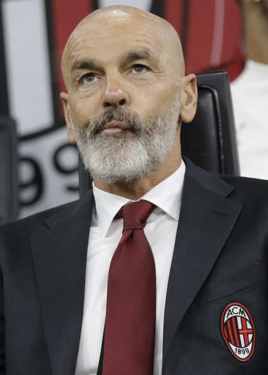 AC Milan's manager Stefano Pioli looks on at the start of Serie A soccer match between AC Milan and Lecce, at the San Siro stadium in Milan, Italy, Su...