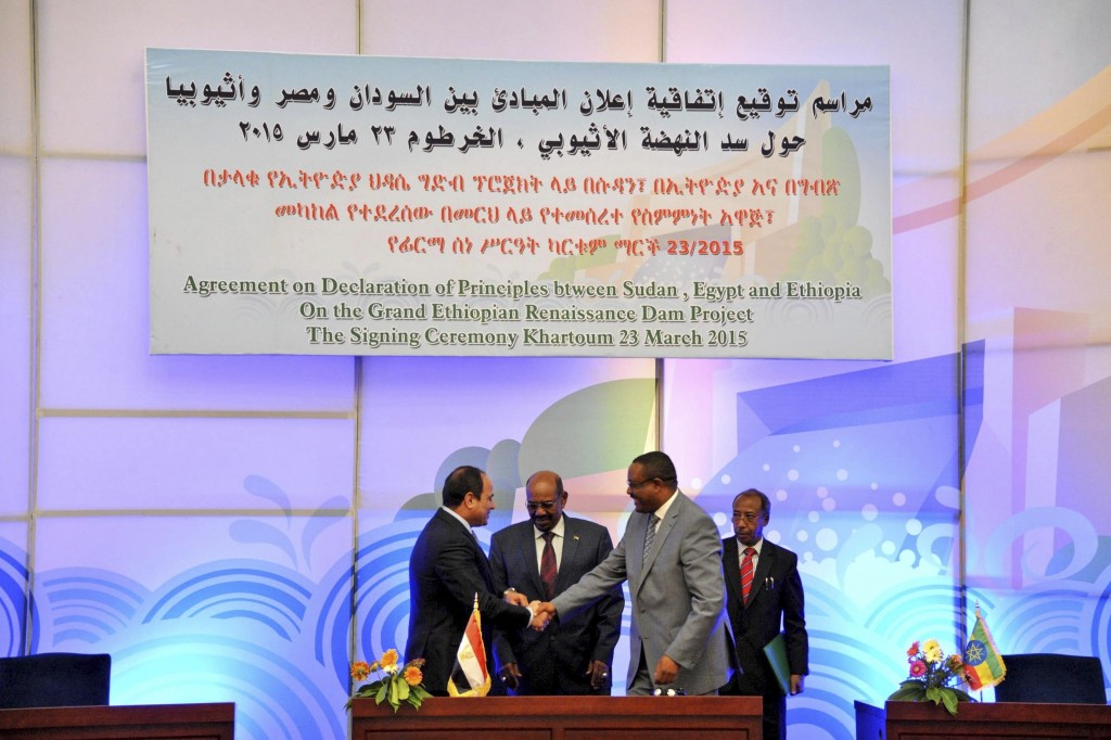 File - In this March 23, 2015 file photo, released by the Egyptian Presidency, then Sudanese President Omar al-Bashir, center, Egyptian President Abde...