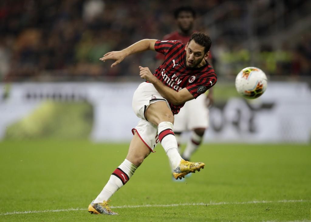 AC Milan's Hakan Calhanoglu kicks the ball during a Serie A soccer match between AC Milan and Lecce, at the San Siro stadium in Milan, Italy, Sunday, ...