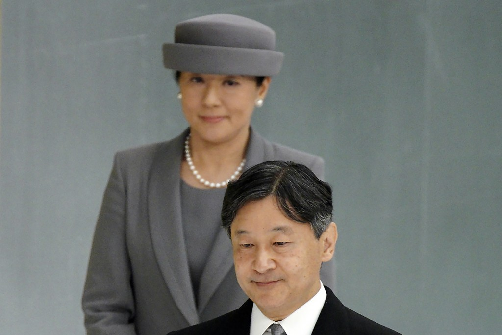 FILE - In this Aug. 15, 2019, file photo, Japanese Emperor Naruhito, accompanied by Empress Masako, walks to deliver his remarks during a memorial cer...