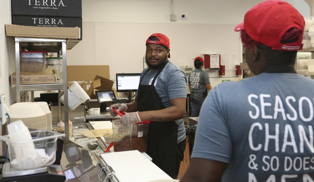 Workers in the B.Good ghost kitchen inside Kitchen United's Chicago, Ill., location prepare food for delivery on Aug. 29, 2019. Kitchen United, a star...
