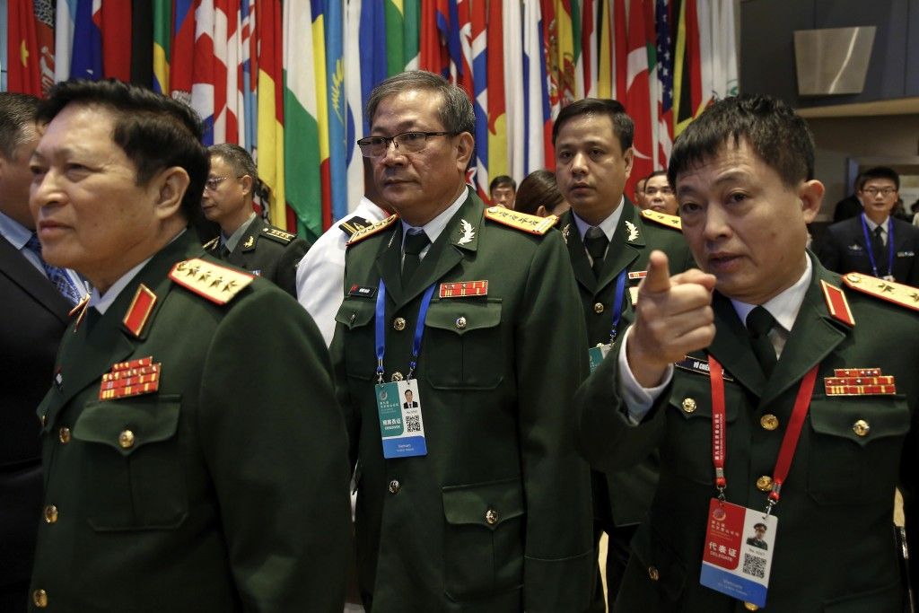 Members of Vietnam military delegation arrive at the Xiangshan Forum, a gathering of the region's security officials, in Beijing, Monday, Oct. 21, 201...
