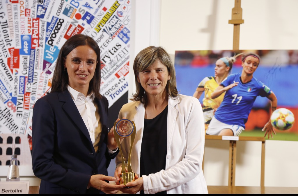 The coach of the Italian women national soccer team, Milena Bertolini, and forward Barbara Bonansea, left, pose with the Invictus sports award, at the...