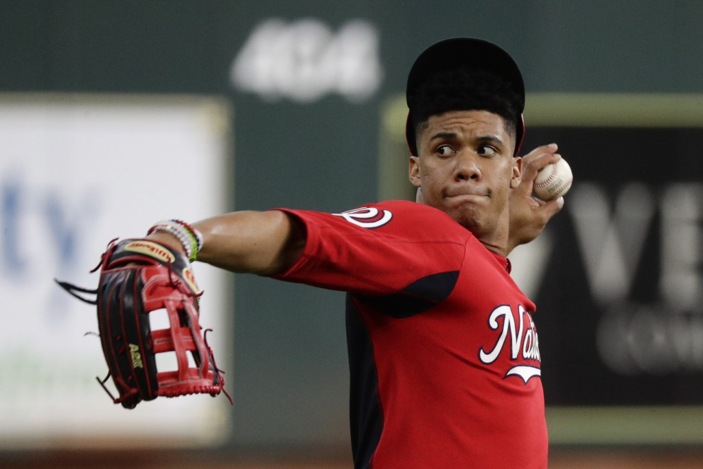 Washington Nationals left fielder Juan Soto warms up during batting practice for baseball's World Series Monday, Oct. 21, 2019, in Houston. The Housto...