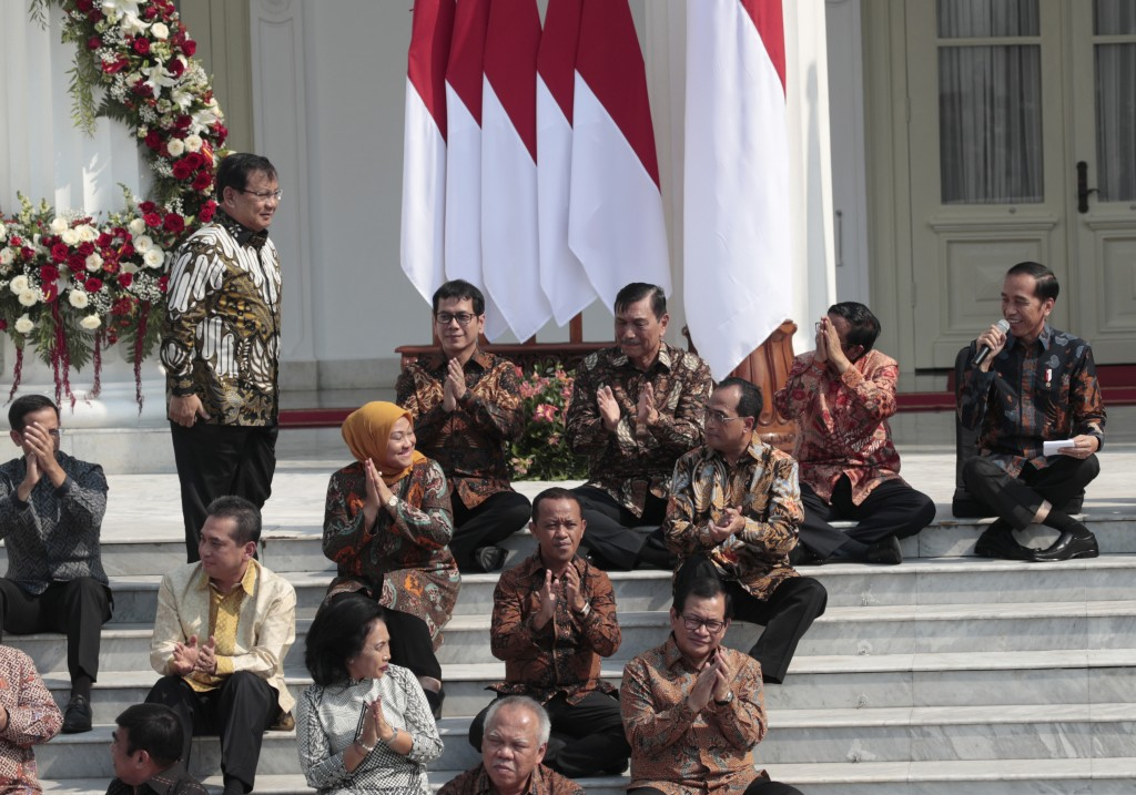 Newly appointed Defense Minister Prabowo Subianto, who is the former rival of Indonesian President Joko Widodo in last April's election, stands up as ...