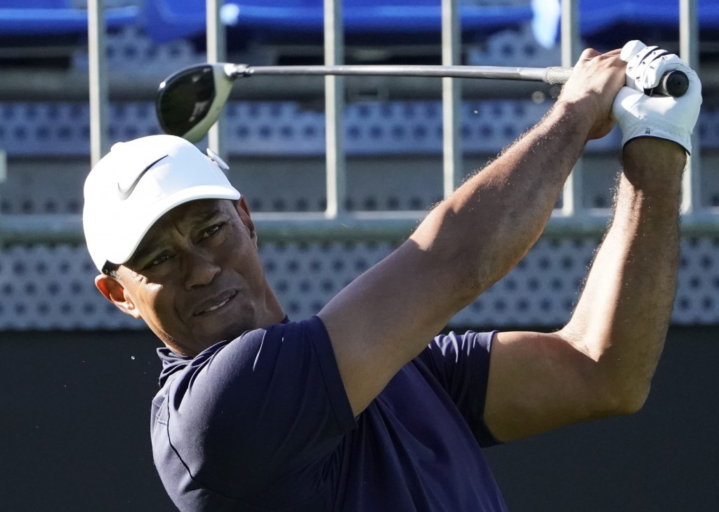 Tiger Woods of the United States watches his tee shot on the 10th hole during the pro-am event of he Zozo Championship PGA Tour at Accordia Golf Naras...