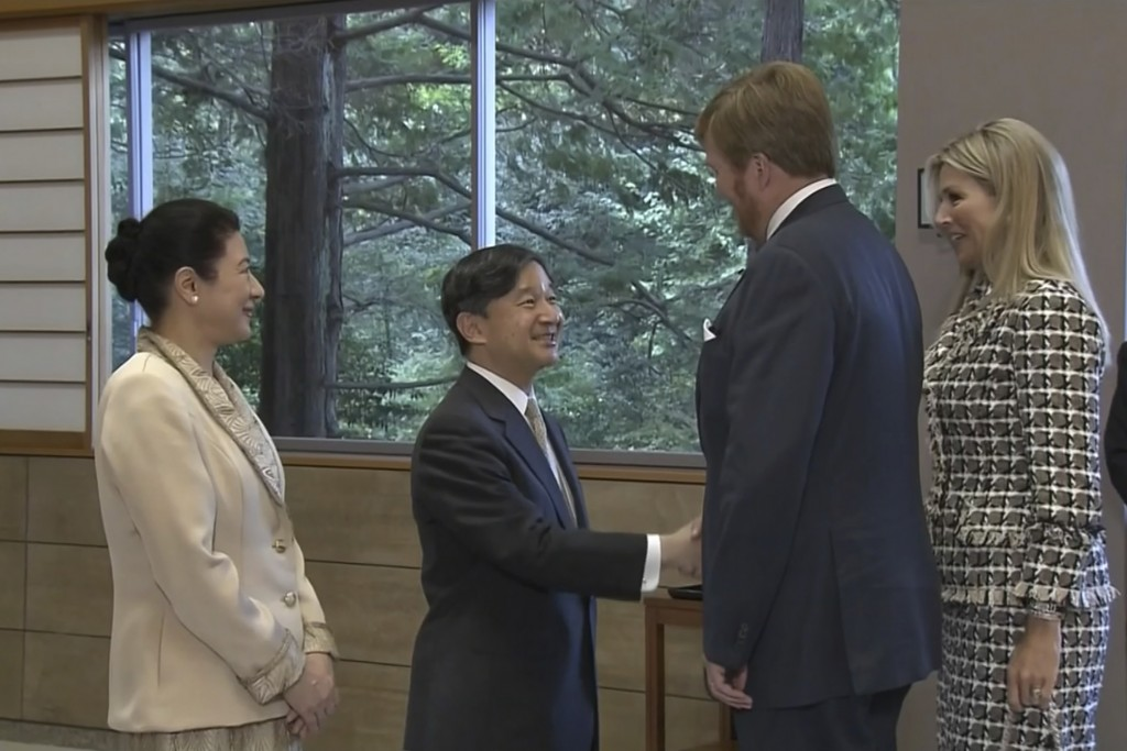 In this image made from video, Japan's Emperor Naruhito, second from left, and Empress Masako, left, welcome King Willem-Alexander of the Netherlands ...