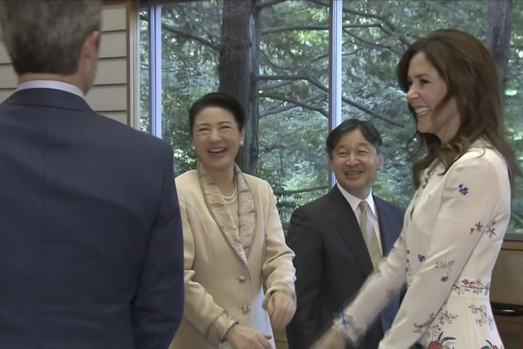In this image made from video, Japan's Emperor Naruhito, second from right, and Empress Masako, second from left, welcome Crown Prince Frederik and Cr...