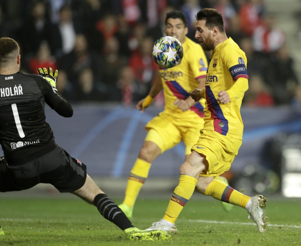 Slavia's goalkeeper Ondrej Kolar, left, makes a save in front of Barcelona's Lionel Messi during the Champions League group F soccer match between Sla...